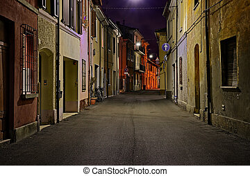 Street at night in the old town of an Italian city