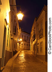 Street at night in the old town of Faro, Portugal