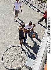 street basketball - group of young boys who playing...