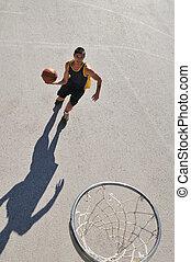 street basketball - gorup of young boys who playing...