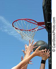 street basketball moment, focused on basketball hoop...
