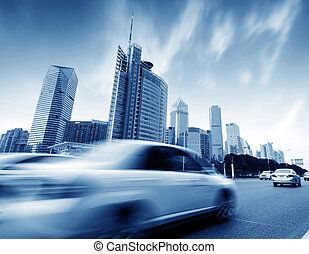 Street buildings and cars motion blur