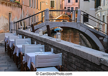 Street cafe in historic centre of Venice, Italy