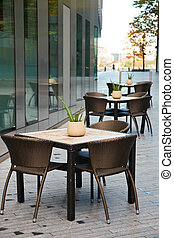 Street cafe in London - Tables with chairs of a sidewalk...