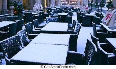 Street cafe in winter. Low season concept. 4K pan shot