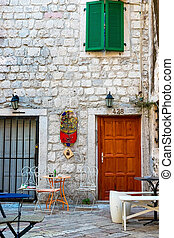 Street cafe on a narrow street in the old town of Kotor, Montenegro
