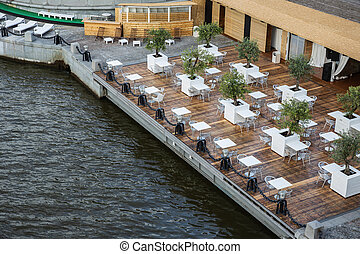 Street cafe on the embankment