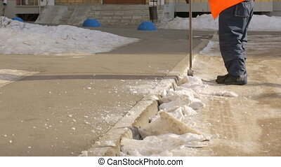Street cleaner chopping compressed snow