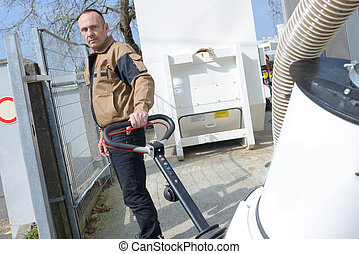 street cleaner man with its equipment