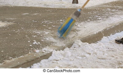 Street cleaner removing snow from road