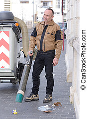 street cleaner vehicle and worker on the road