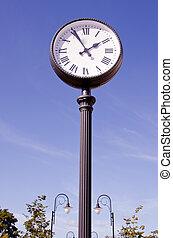 street clock and two lamps