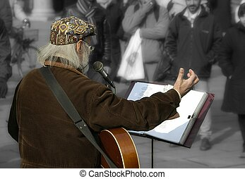 Man entertaining the crowds. Entertainer in color, background converted to b&w and softened. No recognizable faces.