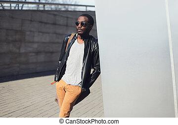 Street fashion concept - handsome stylish african man...