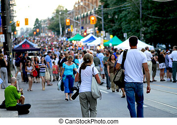A couple of photographers heading into a crowd at jazz street festival