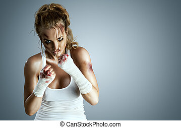 Street fighter. - Aggressive female fighter with bruises...