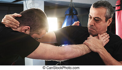 Street fighting self defense technique against holds and...