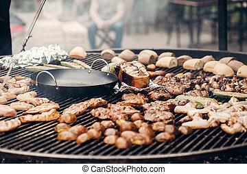 street food festival. grilled meat and vegetables mushrooms. roasting beef pork on big grill, open kitchen, food court. cooking smoked juicy ribs potatoes bbq and bread. summer picnic