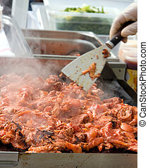 Street food - Food being cooked at a street market