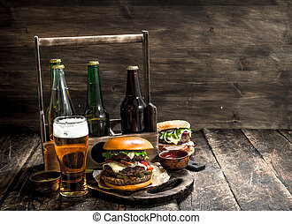 Street food. Fresh burgers with a box of beer.