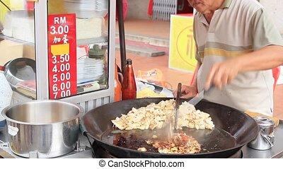 Street Food Vendor Frying Carrot Cake in Melaka Malaysia 1080p Panning