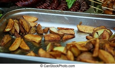 street food fried potato in metal tray - panorama of...