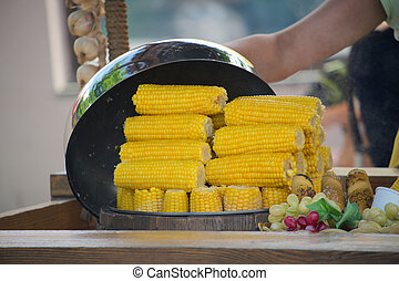 Street food - Hot corn close up on blurred background,...