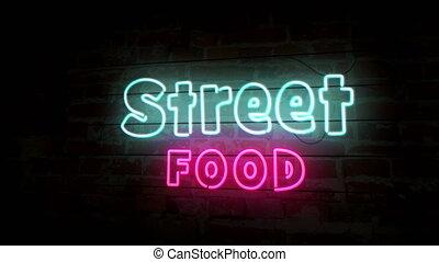 Street food neon symbol on brick wall. Light bulbs animation.