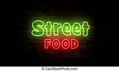 Street food neon on brick wall