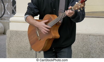 Street Guitarist Playing on the Street. Slow Motion -...