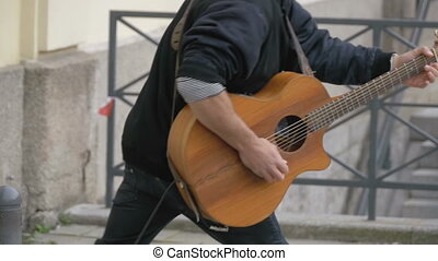 Street Guitarist Playing on the Street. Slow Motion
