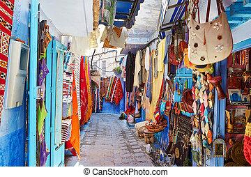 Street in Chefchaouen, Morocco - Street market in...