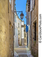 Narrow street in Perigueux city center, France