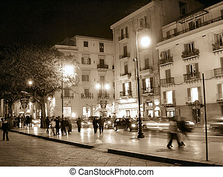 Street in sepia style, looking older and romantic. You can see people in movement, it looks like a 3D photo.