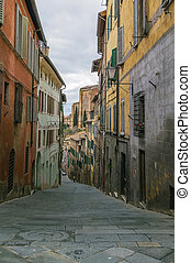 street in Siena, Italy - street in historic center of Siena,...