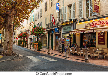 Street in the old town Antibes in France. - ANTIBES, FRANCE...