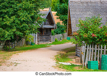 Street in the village with old wooden houses