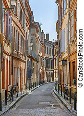 Narrow street in Toulouse historical center, France