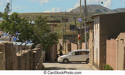 Street Intersection and Mountain - Steady, exterior, wide...