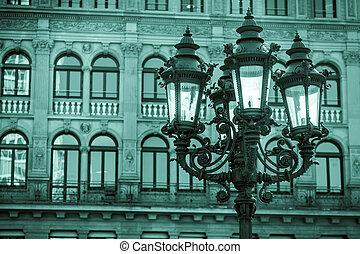 Street Lamp and City Big Buildings