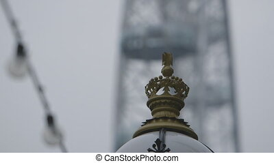 Street Lamp and Ferris Wheel Capsule - Steady, close up shot...
