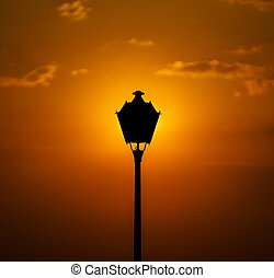 Street lamp on colorful sunset background. Evening in Portugal