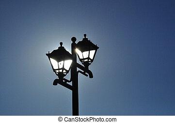 Street lamp illuminated by sun