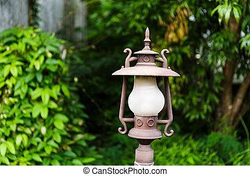 Street lamp in the green garden