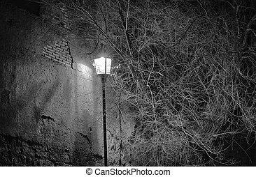 Street lamp near an ancient wall in Rome