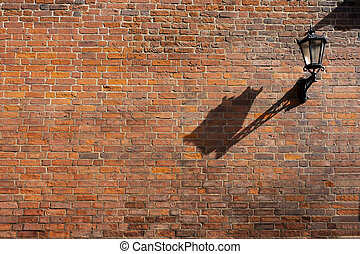 Street lamp on a brick wall