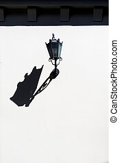 Street lamp on a clean wall