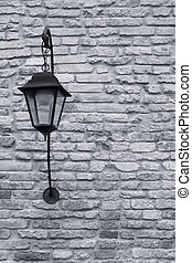 Street lamp on a textured brick wall