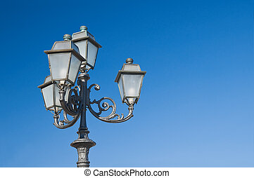 Street-lamp on blue sky.