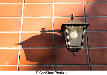Street lamp on brick wall